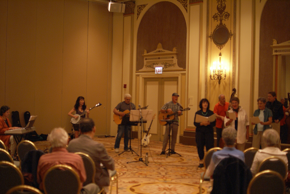 "On the left, Esther plays keyboard, and Mary Gault, Larry Hazard and Bill Lange strum their strings. On the right, songbirds Tery, Annie and Judith perform a tune from our new show, ""Let's Have Fun With This,"" while in the back Michael Lieber, Bass Guitar, and Ken Stefancich, Drummer, keep the beat."