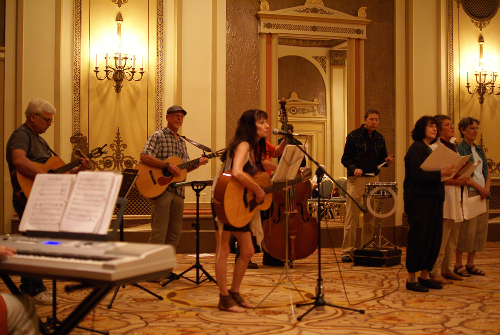 Larry Hazard, Bill Lange and Mary Gault play guitar. Ken Stefancich drums and Tery, Annie and Judith wait for the chorus. Esther, Keyboard, and Michael Lieber, Bass Guitar, are just out of view.
