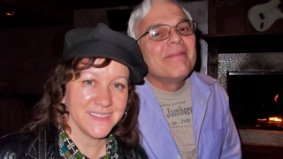 Aimee Bass, Asst. Director, and Larry Hazard. Aimee poses with Larry Hazard, who stars as retiree Joe.
