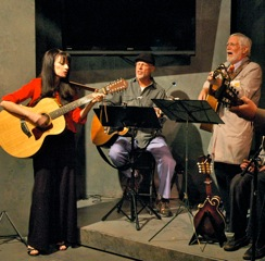 Mary Gault plays guitar with the band.