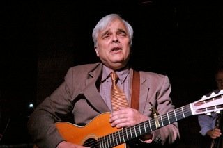 Larry Hazard. As retiree Joe, Larry Hazard acts, sings and plays guitar.