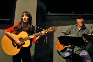Mary Gault and Bill Lange. Mary and Bill play guitar.