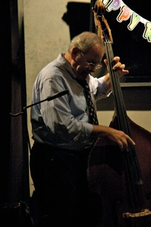 Michael Lieber, Bass. Michael chose a jazz-style bass for the show's Latin numbers. He also plays two different accordions and a five-string banjo in the show. This is Michael's first show with Time of Your Life Players.